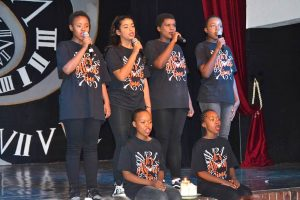 Form One Production - group singing