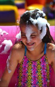 60th birthday celebration girl covered in foam
